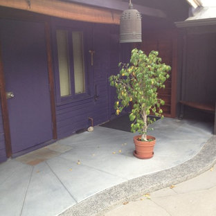 Inspiration for a mid-sized craftsman concrete porch remodel in Los Angeles