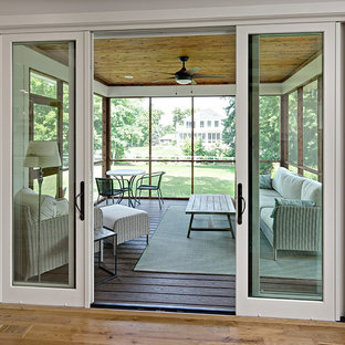 Mid-sized country screened-in back porch photo in Minneapolis with decking and a roof extension