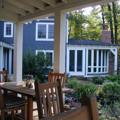 This is an example of a mid-sized farmhouse back porch design in Detroit with decking and a roof extension.