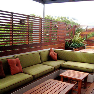 This is an example of a mid-sized contemporary back porch design in Los Angeles with decking and a pergola.