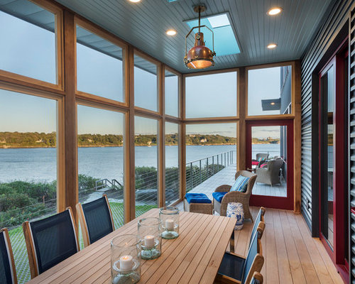 This Is An Example Of An Industrial Screened In Porch Design In Providence  With Decking