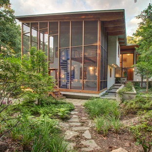 Inspiration for a large contemporary screened-in back porch remodel in Boston with decking and a roof extension