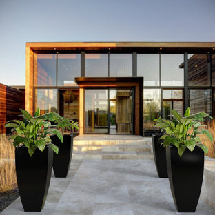 Inspiration for a large contemporary stone front porch remodel in Toronto