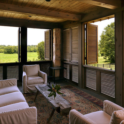 This is an example of a farmhouse porch design in Birmingham with decking and a roof extension.