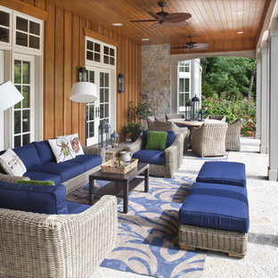 This is an example of a mid-sized traditional back porch design in Milwaukee with a roof extension.