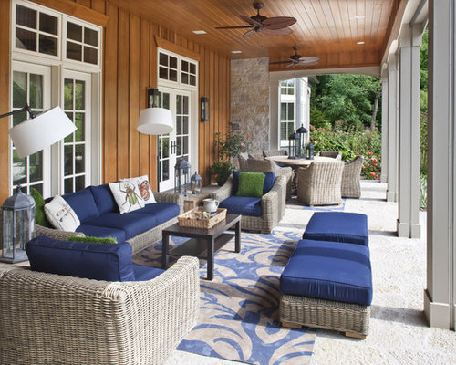 This Is An Example Of A Mid Sized Traditional Back Porch Design In Milwaukee  With