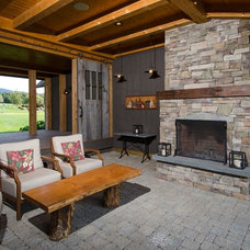 Rustic Porch by Moore Design Builders