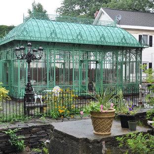 Foto di un patio o portico vittoriano dietro casa