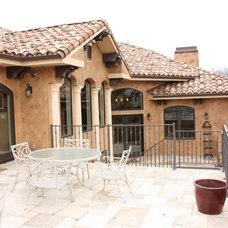 Mediterranean Porch by Phoenix Contractors, Inc.