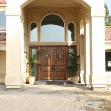 Mediterranean Porch by Newland Construction Inc
