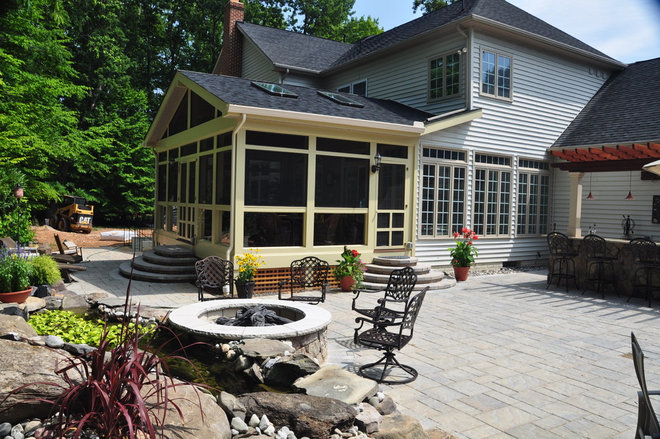 Traditional Porch by Land & Water Design