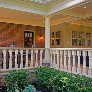 Classic back porch idea in Louisville with a roof extension