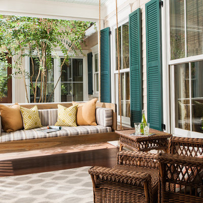 Trendy front porch idea in Atlanta with a roof extension and decking