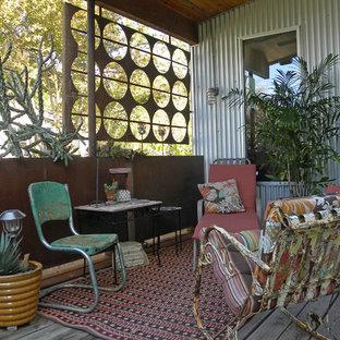 Ispirazione per un portico boho chic con un giardino in vaso