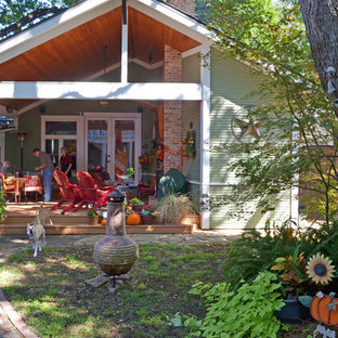 Inspiration for a craftsman porch remodel in Dallas with a roof extension