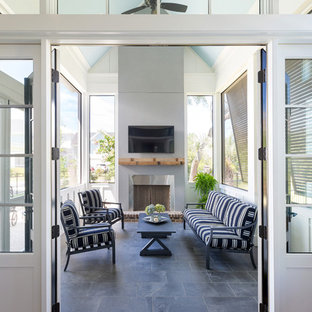 Small beach style screened-in side porch idea in Charleston with decking and a roof extension