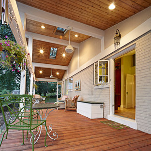 Country porch photo in St Louis with decking
