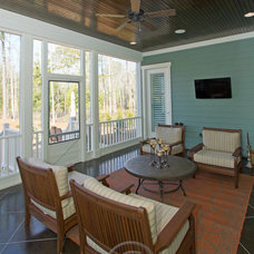 Traditional Porch by plantation building corp