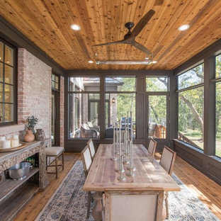 Large elegant screened-in back porch photo in Chicago with decking and a roof extension
