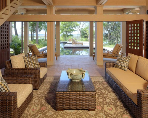 This Is An Example Of A Large Tropical Porch Design In Atlanta.