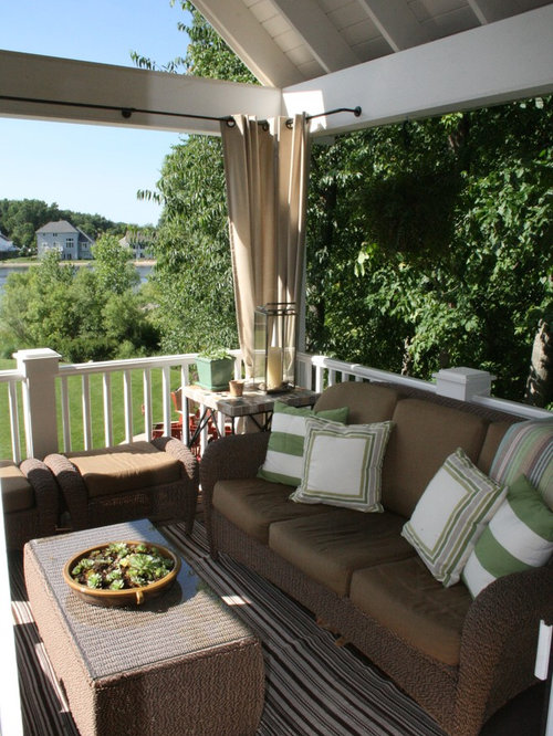 inspiration for a timeless porch remodel in grand rapids with a roof extension - Outdoor Curtain Rods