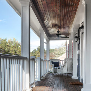 Inspiration for a mid-sized timeless front porch remodel in DC Metro with a roof extension