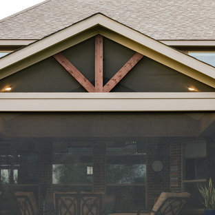 This is an example of a traditional porch design in Dallas.