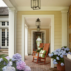 Traditional Porch by Burns and Beyerl Architects
