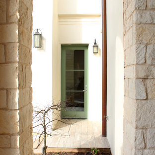 This is an example of a mid-sized traditional tile front porch design in Dallas with a roof extension.