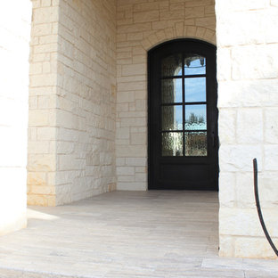 Inspiration for a mid-sized timeless tile front porch remodel in Dallas with a roof extension