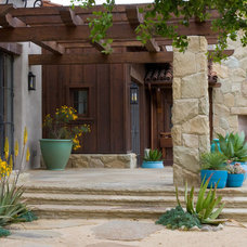 Mediterranean Porch by Lane Goodkind Landscape Architect