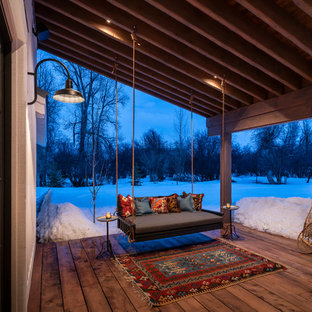 Country porch photo in Salt Lake City with decking and a roof extension