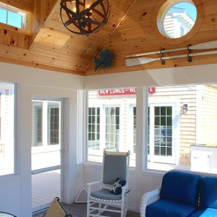 Mid-sized elegant screened-in back porch photo in Boston with decking and a roof extension