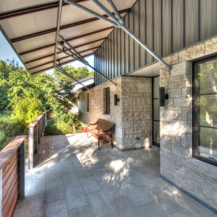 Inspiration for a mid-sized contemporary tile front porch remodel in Austin with an awning