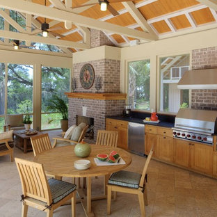 Inspiration for a mid-sized timeless tile porch remodel in Atlanta with a roof extension