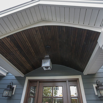 Exterior remodeling in Naperville with siding replacement and porch build out