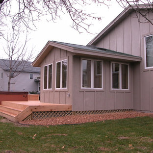 Small classic porch idea in Minneapolis with decking and a roof extension