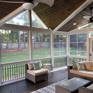 Mid-sized transitional screened-in back porch photo in Charlotte with decking and a roof extension