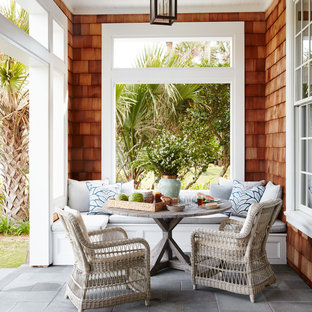 Inspiration for a mid-sized beach style stamped concrete side porch remodel in Jacksonville with a roof extension