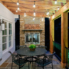 Traditional Porch by June DeLugas Interiors