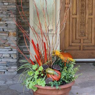 Small arts and crafts stone porch idea in Calgary
