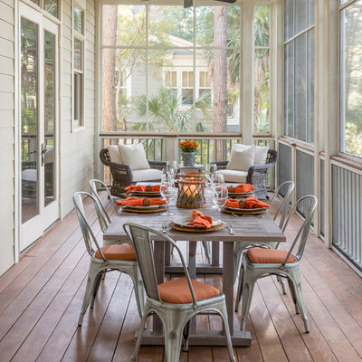 Cottage screened-in porch photo in Houston with decking and a roof extension