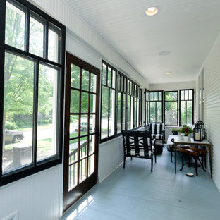 Photo of a small country front yard screened-in verandah in Chicago with a roof extension.