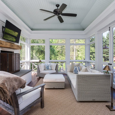 Inspiration for a farmhouse screened-in porch remodel in Other with decking and a roof extension
