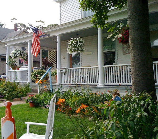 Porch life 12 ways to beautify a porch with plants - Growing petunias pots balconies porches ...