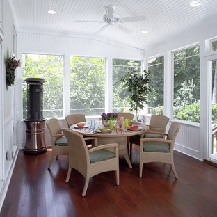 Classic screened-in porch idea in DC Metro with decking and a roof extension