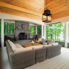 Traditional Porch by Arnal Photography