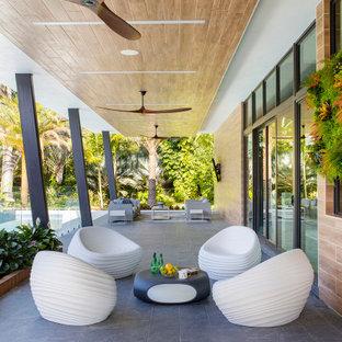 Large trendy porch idea in Miami