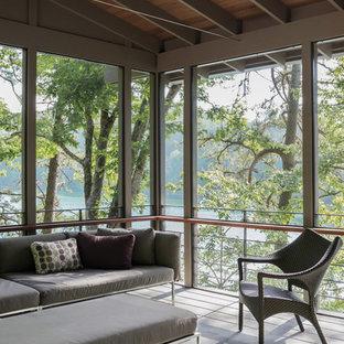 Idee per un portico minimalista di medie dimensioni e nel cortile laterale con un portico chiuso, pavimentazioni in pietra naturale e un tetto a sbalzo