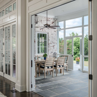 Large transitional backyard screened-in verandah in Nashville with tile and a roof extension.